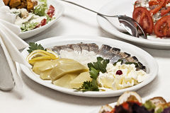 Snack from a herring with potatoes. On a table there is a dish with snack from a herring and potatoes Stock Photography