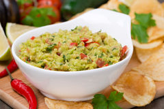 Snack - Mexican sauce guacamole and chips in a bowl Royalty Free Stock Photography