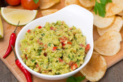 Snack - Mexican sauce guacamole and chips, top view Stock Images