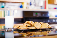 Snack of milk and cookies on kitchen counter Royalty Free Stock Photography