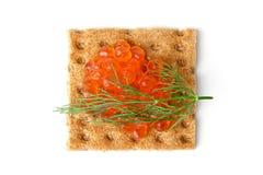 Snack mit rotem Kaviar Stockfoto