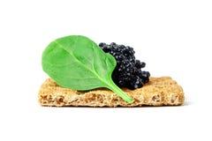 Snack mit schwarzem Kaviar Stockbild