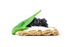 Snack mit schwarzem Kaviar Stockfotografie