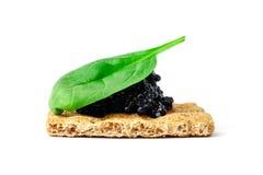 Snack mit schwarzem Kaviar Lizenzfreie Stockfotografie
