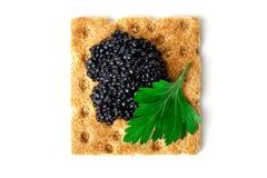 Snack mit schwarzem Kaviar Lizenzfreies Stockfoto