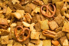 Snack Mix Background. Close Up of cereal, pretzel, and nut snack mix background Royalty Free Stock Photos