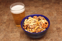 Snack mix and beer Stock Photography