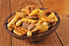 Snack mix. A bowl of snack mix with rice cereal, pretzels and cheese sticks Stock Photos