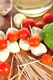 Snack with mozzarella and party tomato is prepared Stock Photos
