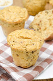 Snack muffins with dried peppers and onions on a plate vertical Stock Photography