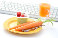 Snack in the office. Healthy snack in the office - yogurt and fresh fruits and vegetables Stock Photography