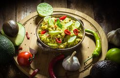 Snack party avocado paste tomato chilli pepper lime onion garlic stock photos
