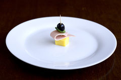 Snack on plate. Little snack on white plate Royalty Free Stock Photography