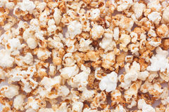 Snack popcorn a texture background. Stock Photos