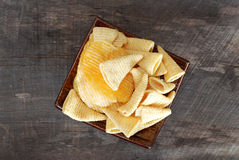 Snack potato crisp corn chips. On the old wooden floor Royalty Free Stock Photography