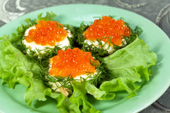 Snack with red salmon caviar stock images