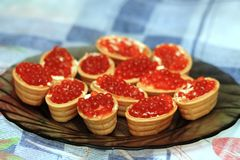 Snack from red salmon caviar. On a plate Royalty Free Stock Images