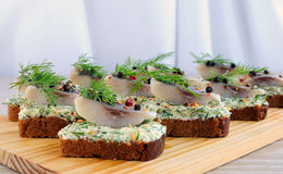 Snack rye bread and herring Royalty Free Stock Photo