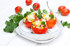 Snack salad in tomatoes Stock Photos