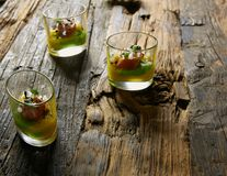 Snack from salmon and puree from avocado in a glass. Film effect.  Royalty Free Stock Photos