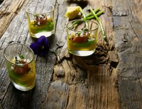 Snack from salmon and puree from avocado in a glass. Film effect.  Stock Photography