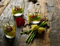 Snack from salmon and puree from avocado in a glass. Film effect.  Stock Image