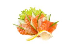 Snack from salmon with segment lemon. On white background Royalty Free Stock Photo