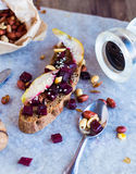 Snack sandwich with roasted beets, nuts, pear and sesame Stock Photography