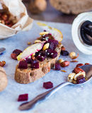 Snack sandwich with roasted beets, nuts, pear and sesame Royalty Free Stock Photos