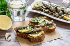 Snack from sandwiches with sardines. Royalty Free Stock Photos