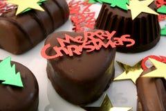 Snack for Santa. Chocolates with Christmas sparkles Royalty Free Stock Photos