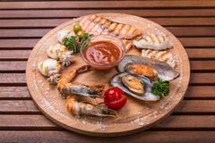 Snack from seafood - fish, cuttlefish, shrimp, mussel on wood Royalty Free Stock Photography