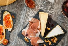 Snack set: cheese, prosciutto, nuts Royalty Free Stock Image