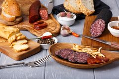 Variety of salami, cheese chechil and bread stock image