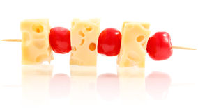 Snack shish kebab of cheese and cherry Stock Photo