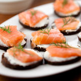 Snack with smoked salmon. Close up of canapes with salmon and cheese Stock Photo