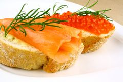 Snack with smoked salmon and keta eggs Stock Photo