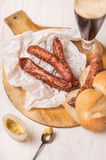 Snack with smoked sausage,glass of beer and bread Stock Photo