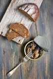 Snack - sprats and bread. Royalty Free Stock Image