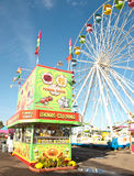 Snack stand. Fried food stand and ferris wheel on a fair midway Stock Photo