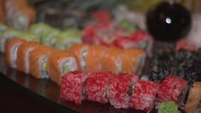 Snack sushi. Tobiko sushi with wasabi, soy sauce and flying fish roe stock video footage