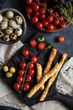 Snack table with bread, eggs and tomato. View from the top. royalty free stock image