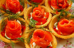 Tartlets with red fish and dill royalty free stock image