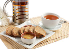 Snack of tea and corn bread with honey and nuts. A light snack of tea and corn bread with honey and nuts, white ware.  Isolated on white Stock Photos