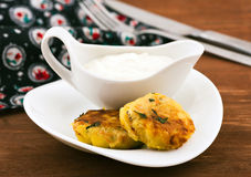 Snack time. Potatoes cutlet with sour cream Royalty Free Stock Photography