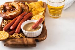 Snack to beer, Bavarian sausages, chips, brezels, crackers and mustard. Oktoberfest food. Snack to beer, Bavarian sausages, chips, brezels, crackers and mustard royalty free stock photos