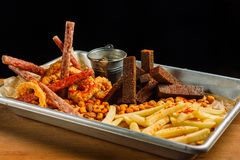 Snack to beer. Beer metal tray with a mountain of food. stock image