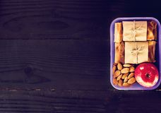 Snack to school, snack to work, lunch with you, pie. apple and nuts in a container. Royalty Free Stock Photography