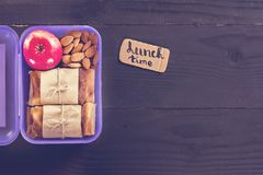 Snack to school, snack to work, lunch with you, pie. apple and nuts in a container. Royalty Free Stock Photos