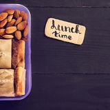 Snack to school, snack to work, lunch with you, pie. apple and nuts in a container. Royalty Free Stock Photo